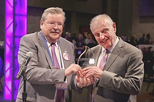 James F. Donohue (left), the ATS Foundation Board of Trustees chair, presents the 2015 Breathing for Life Award to Marvin Schwarz.