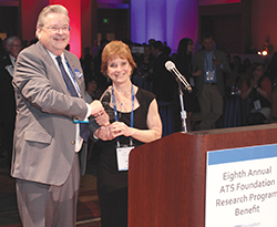 James F. Donohue (left), the ATS Foundation Board of Trustees chair, presents the 2015 Breathing for Life Award to Sally E. Wenzel, MD, in recognition of her research into severe asthma, advocacy for women in science, and mentoring of young scientists.