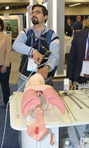 An attendee uses the TipControl, a set of articulating forceps developed by Richard Wolf Medical Instruments for use in rigid bronchoscopy.
