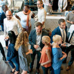 A group of people connecting at a networking event