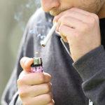 A man lighting a cigarette