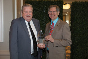 James F. Donohue, MD, (left) accepts the Breathing for Life Award from ATS Foundation Chair Dean Schraufnagel.