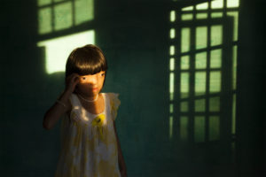 Nguyen Thi Ly, 9, who suffers from Agent Orange disabilities, in her home in Ngu Hanh Son district of Da Nang, Vietnam.